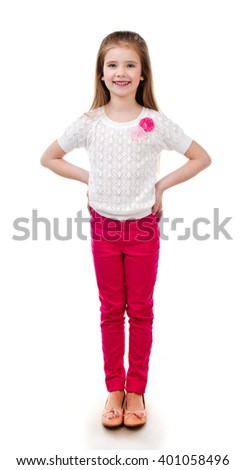 Adorable smiling little girl in pink jeans isolated on a white - stock photo
