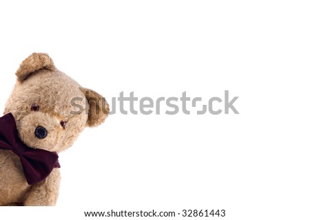 Adorable Teddy Bear with a bow tie   on white - stock photo