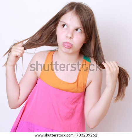 Beautiful little girl wearing blue jeans stock photo for Beautiful small teen