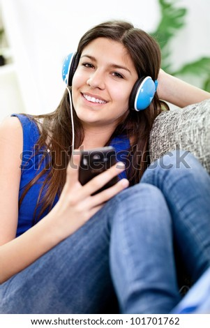 Adorable teenage girl relaxing and  listening music