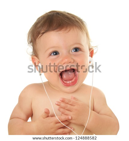 Adorable ten month old baby listening to music on ear buds. - stock photo