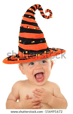 Adorable ten month old baby wearing a Halloween witch hat.  - stock photo