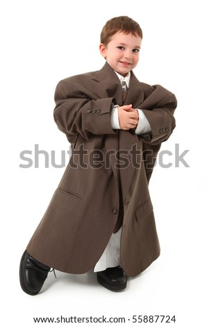 Adorable three year old american boy in over sized suit on white. - stock photo