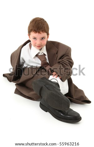 Adorable three year old american boy in over sized suit over white. - stock photo