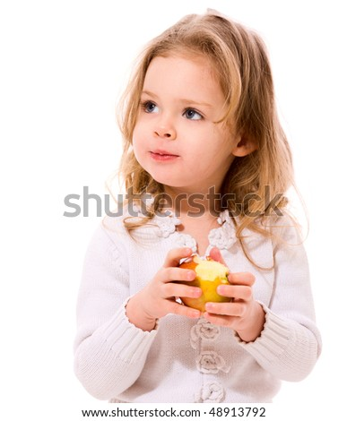 Adorable toddler Girl eating apple isolated on white
