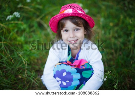Adorable toddler girl In a hat outdoor
