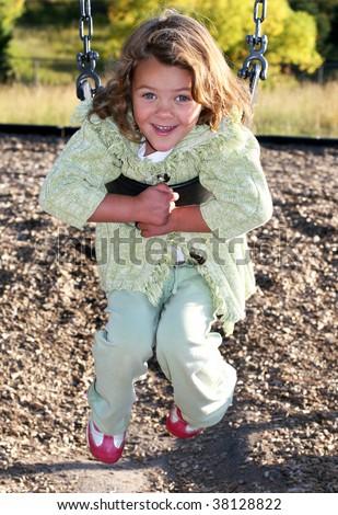 adorable toddler girl on swing - stock photo