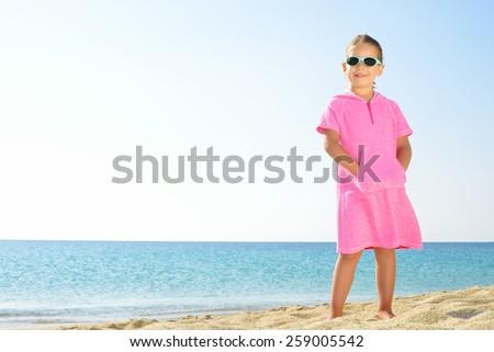 Adorable toddler girl on the beach - stock photo