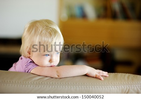 Adorable toddler girl portrait at home