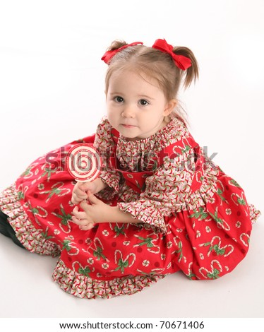Adorable toddler girl wearing a Christmas holiday outfit posing, isolated on white - stock photo