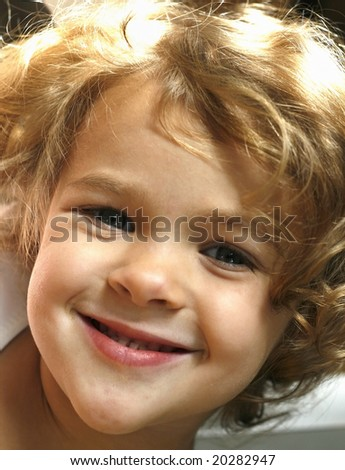 adorable toddler girl with curly hair, smiling