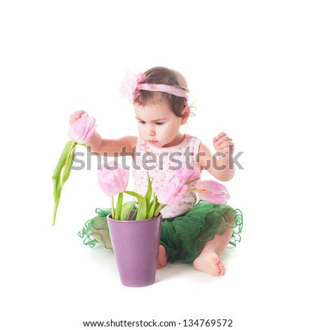Adorable toddler girl with pink tulips, isolated on white - stock photo