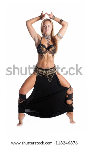 Adorable woman bellydancer dancing in traditional tribal costume. Portrait of oriental artist  in ethnic wear. - stock photo