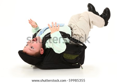 Adorable 3 year old child knocked backwards from a heavy back pack over white background. - stock photo