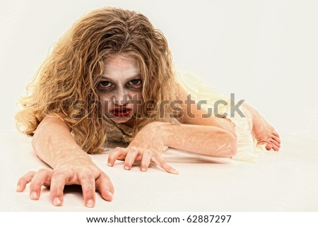 Adorable 7 year old girl in Zombie costume over white background. - stock photo