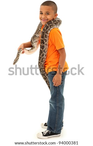 Adorable Young Black Boy Holding pet Python Over White Background.