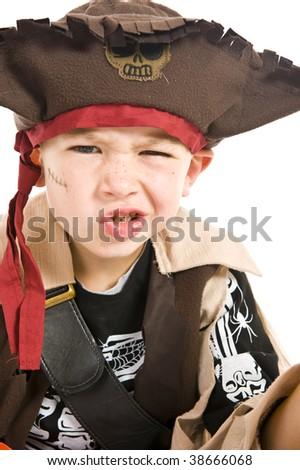 Adorable young boy dressed in a pirate outfit, playing trick or treat for Halloween.