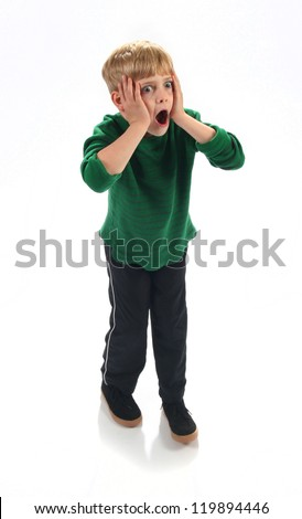 Adorable young boy freaking out on Christmas morning - stock photo
