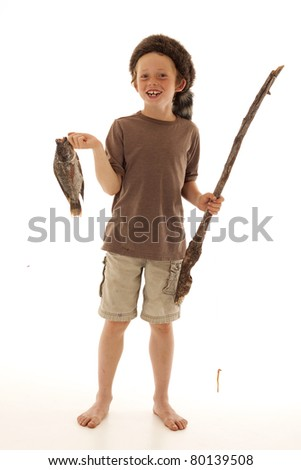 adorable young boy holding fish and pole - stock photo