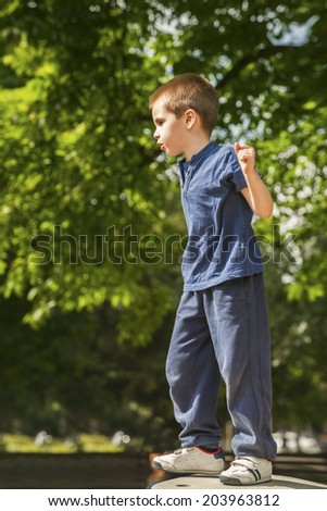 Adorable young boy playing in the playground - stock photo