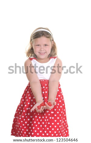 Adorable young girl holding candy hearts for Valentine's Day - stock photo