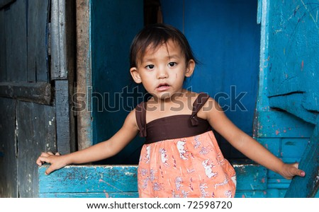 Adorable young girl living in poverty. Manila, Philippines. - stock photo