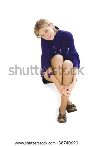 Adorable young sexy woman sitting on the floor isolated over white - stock photo