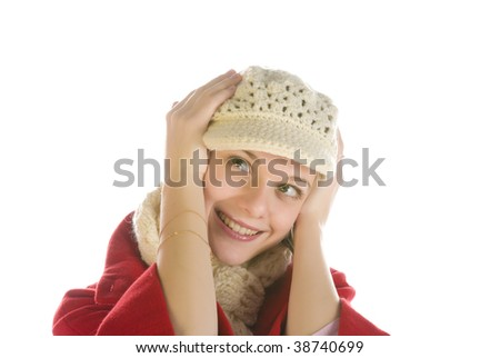 Adorable young woman holding her head in a winter cap isolated over white - stock photo