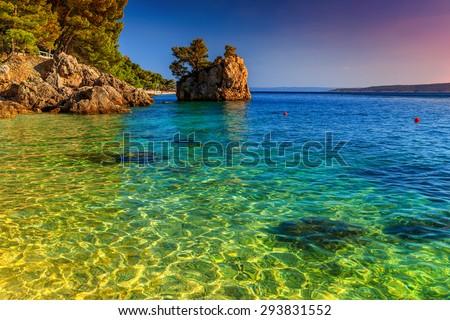 Adriatic coast of Brela,with stunning sunset,Makarska riviera,Dalmatia,Croatia,Europe - stock photo