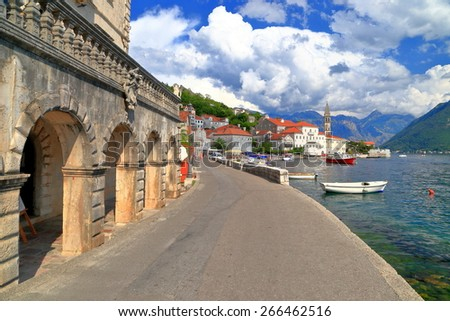 Adriatic sea shore sided by sunny road and old buildings, Perast, Montenegro - stock photo