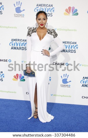 Adrienne Bailon at the 2nd Annual American Giving Awards held at the NPasadena Civic Auditorium in Los Angeles, California, United States on December 7, 2012.   - stock photo