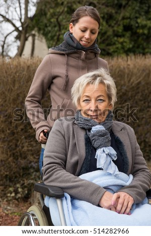adult and senior woman, one in a wheelchair
