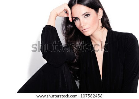 adult beautiful black hair stylish woman portrait studio shot - stock photo