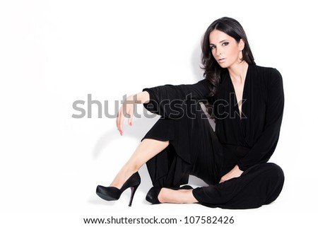 adult beautiful black hair stylish woman sit down full body shot studio white - stock photo