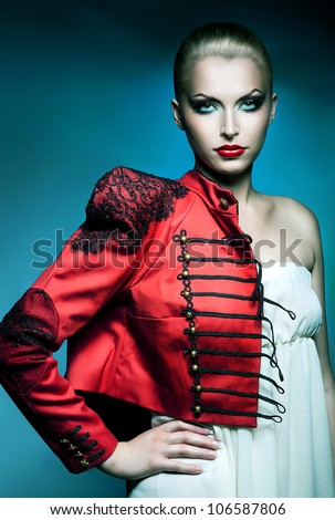 adult beautiful blonde woman in red jacket with red lips - stock photo