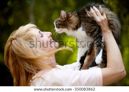 Adult beautiful emotional woman show love to your cat. - stock photo