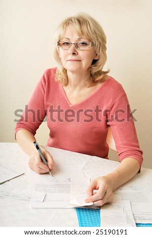 Adult blond woman signing documents