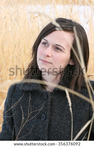 Adult brunette female in a rural setting - stock photo