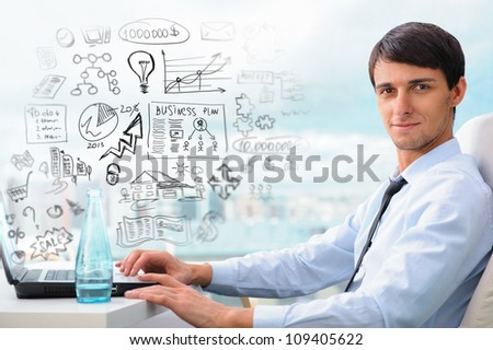 Adult business man sitting at his office and planning his business future - stock photo