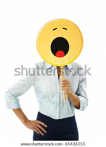 adult business woman holding emoticon, yawning on white background. Vertical shape, waist up - stock photo