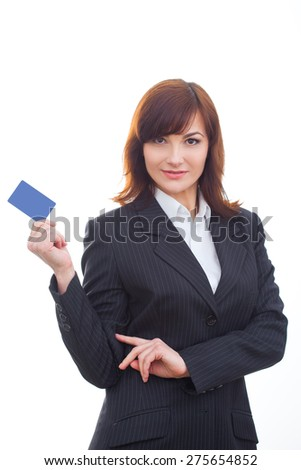 adult business woman holding showing credit card smiling happy in suit - stock photo