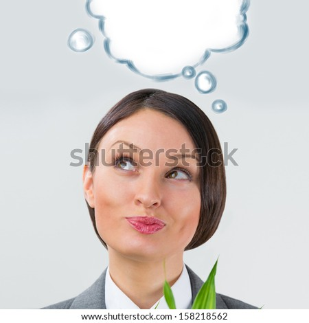Adult business woman looking up and holding lucky bamboo plant symbol of success. Business growing and ideas concept. Blank cloud balloon with copyspace overhead - stock photo
