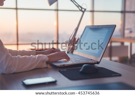 Adult businesswoman working at home using computer, studying business ideas on a pc screen on-line - stock photo