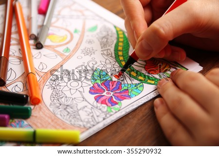 Adult colouring with soft tip pencils - stock photo