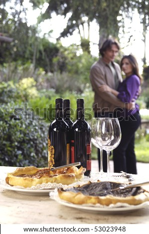 Adult couple in a country farm with wine - stock photo