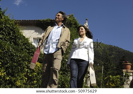Adult couple in a country villa - stock photo