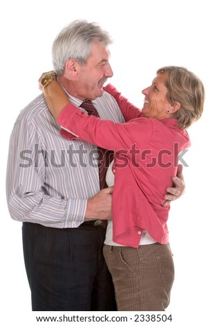 Adult couple smiles and hugs each other - stock photo