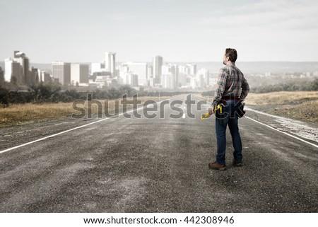 Adult engineer man . Mixed media - stock photo