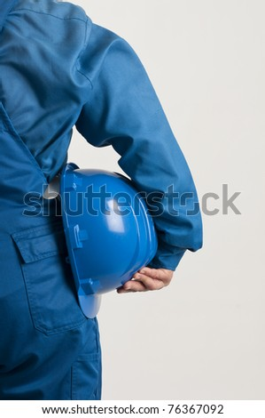 adult enginner holding a blue helmet