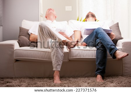 adult friends having fun like teenagers in a living room - stock photo